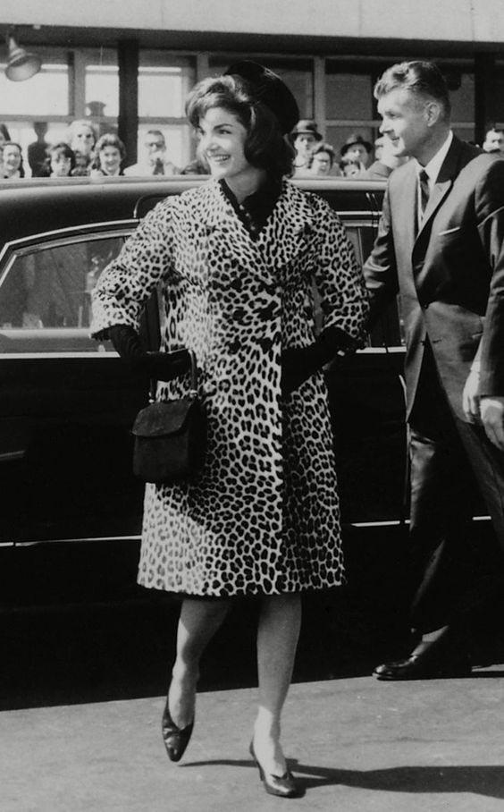 Jackie Kennedy wears a Cassini Leopard skin coat